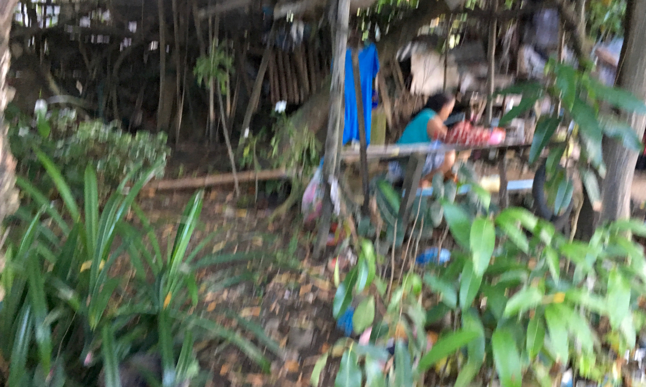 out of focus shot of an old lady handwashing